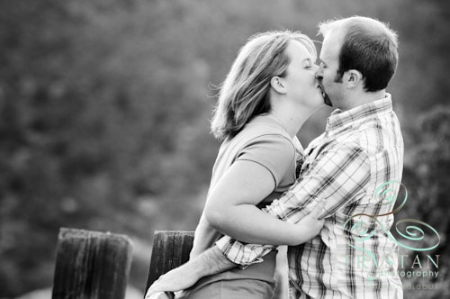 An engaged couple kissing at the Garden of the Gods.